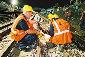 Tube Lines staff carrying out track maintenance. Image:Tube Lines