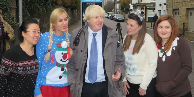 Mayor Boris Johnson meets  some Christmas well-wishers in South West London.