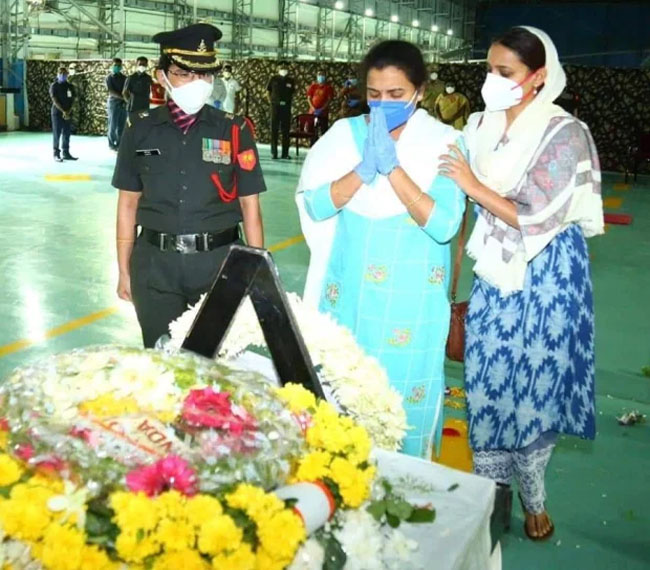 Family members pay their respects at the coffin of Colonel B Santosh Babu