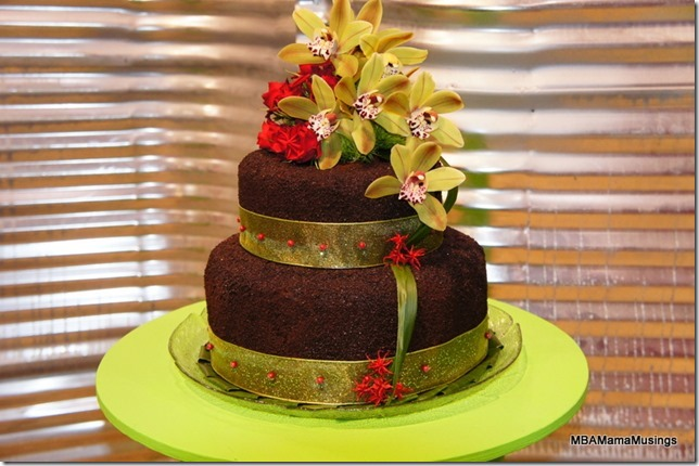 Two tiered chocolate and green cake made out of flowers