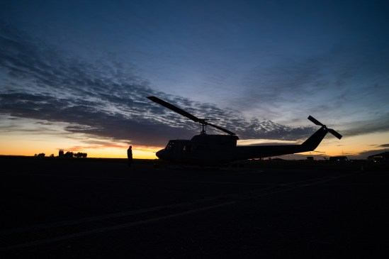 Military vietnam helicopter and mechanic silhouette on sunrise