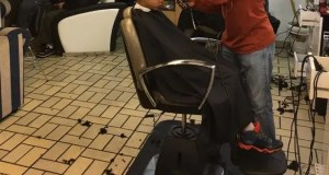 File picture of a barber giving a haircut