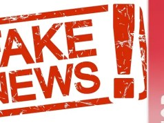 red stamp with text Fake News