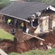 Heavy rain washes away part of KZN house and road