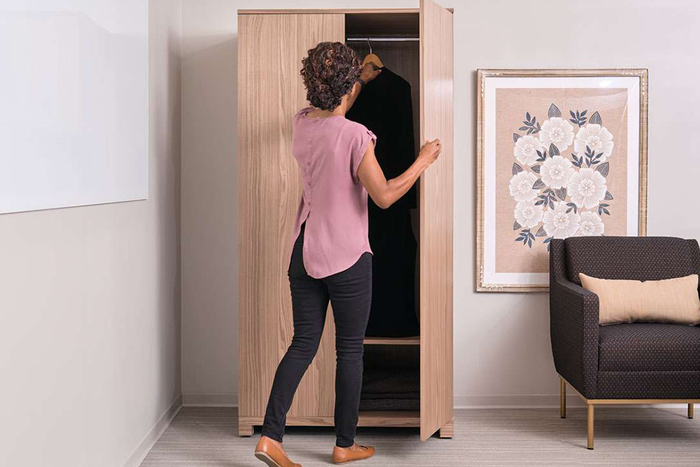 lady opening wardrobe closet door