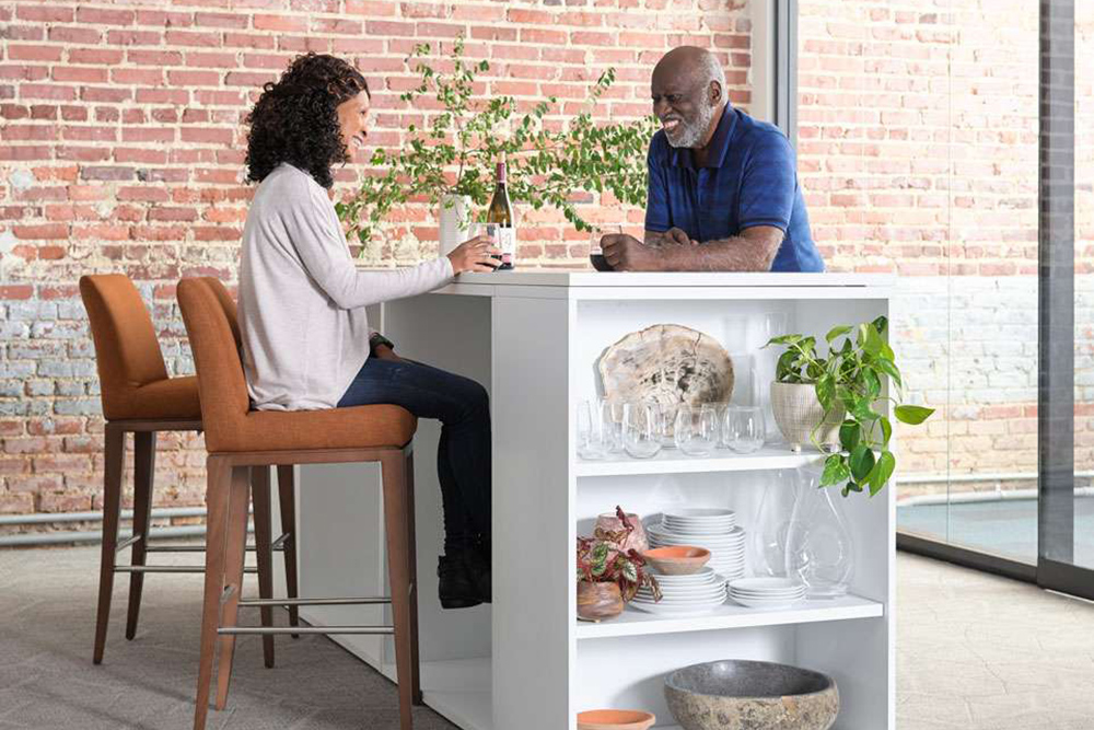 woman and man chatting in lobby furniture