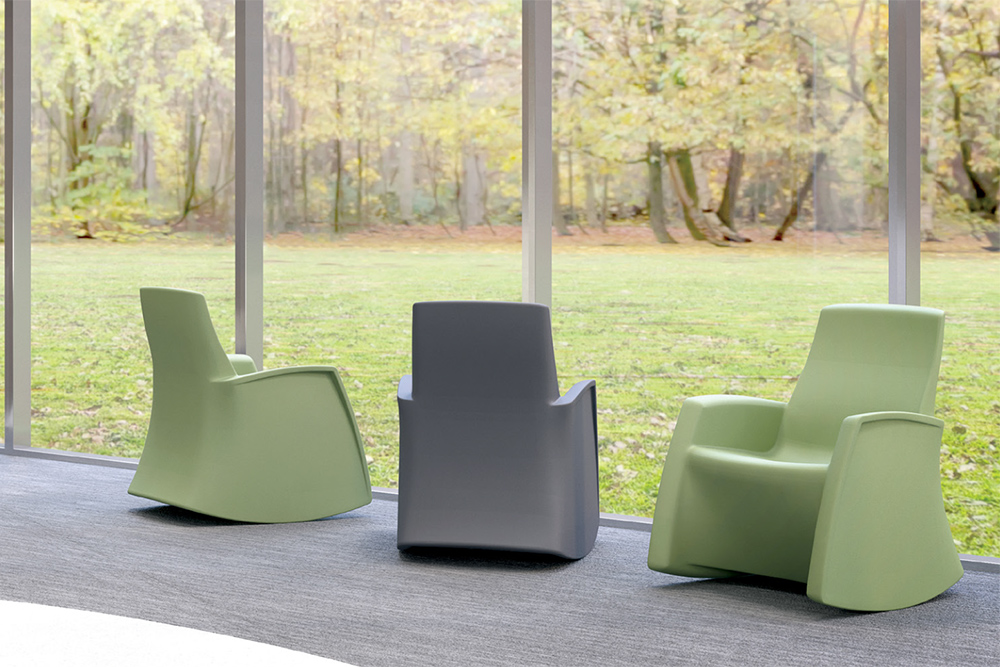 Green chair facing window