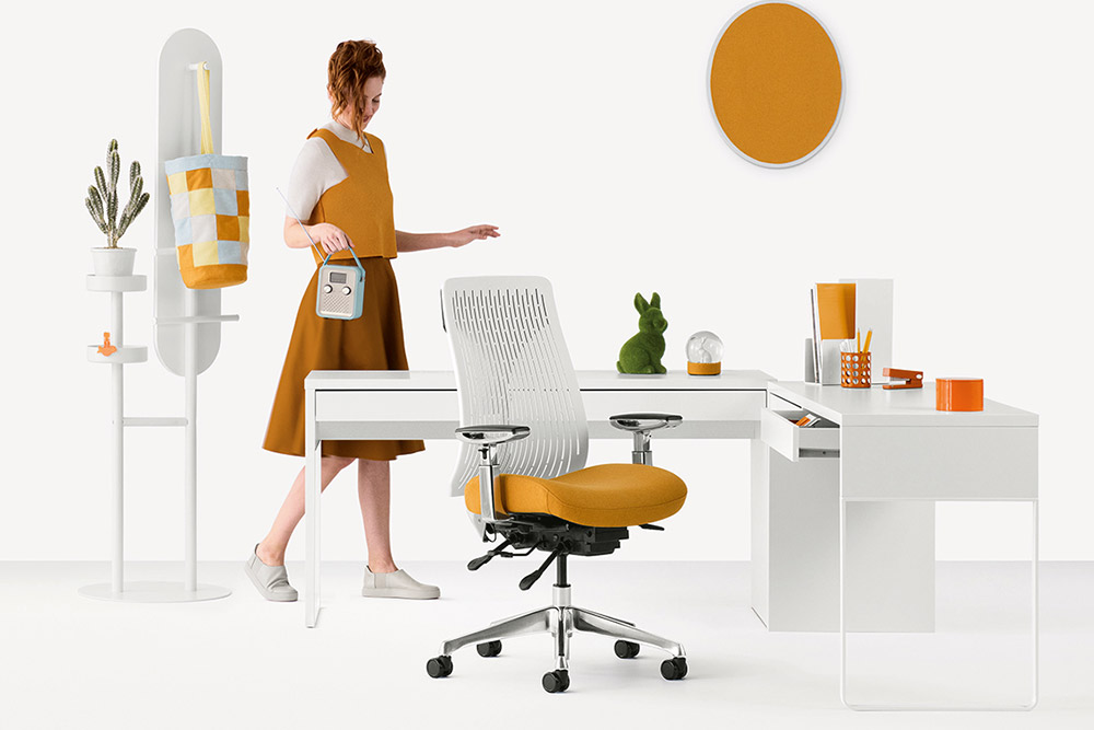 Lady standing behind home office desk furniture