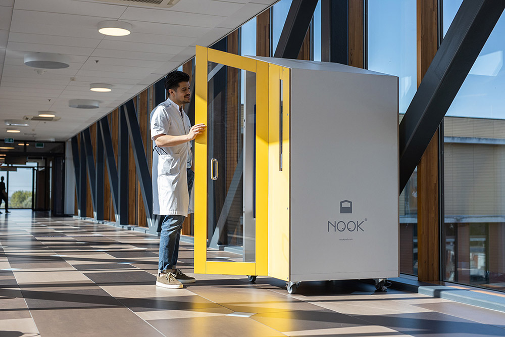 Man opening door to a privacy booth