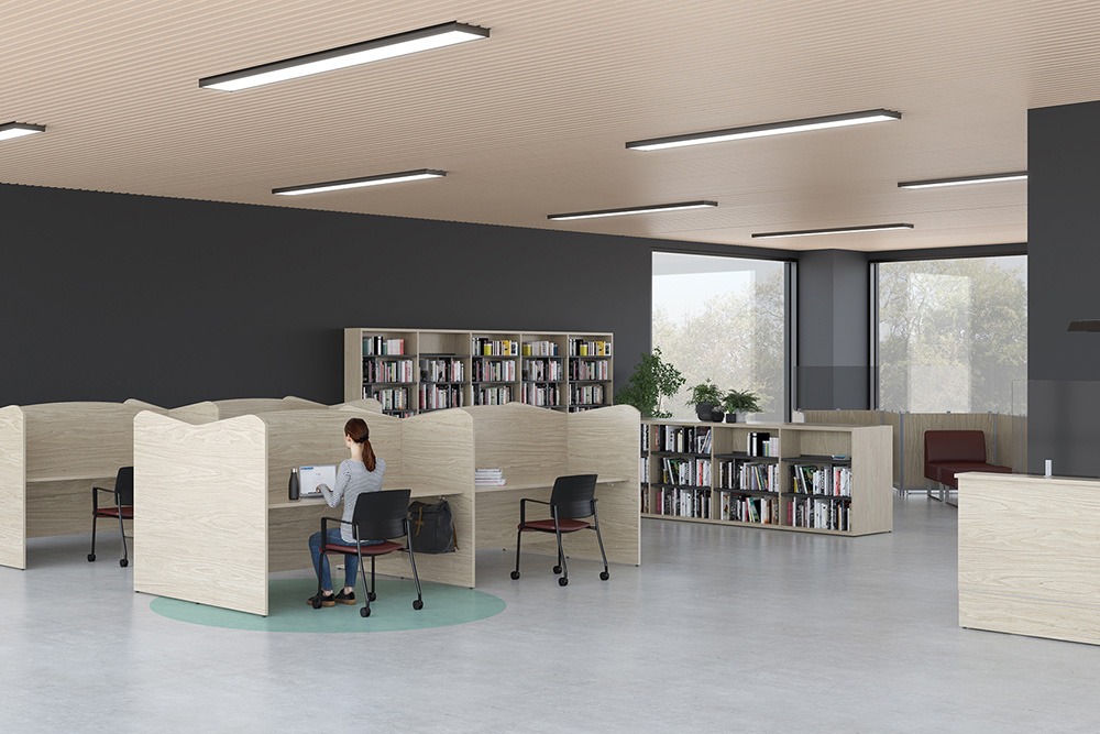 Library with protective screens on desks and stations