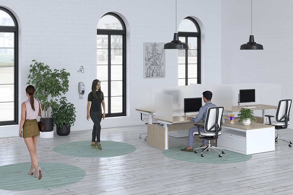 Social Distancing at office with protective screens on workstations