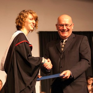 Bethany president Howie Wall congratulates Brittany Suderman, winner of the 4th-year academic award