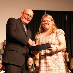 Bethany president Howie Wall congratulates Cherie Bright, winner of the 1st-year academic award