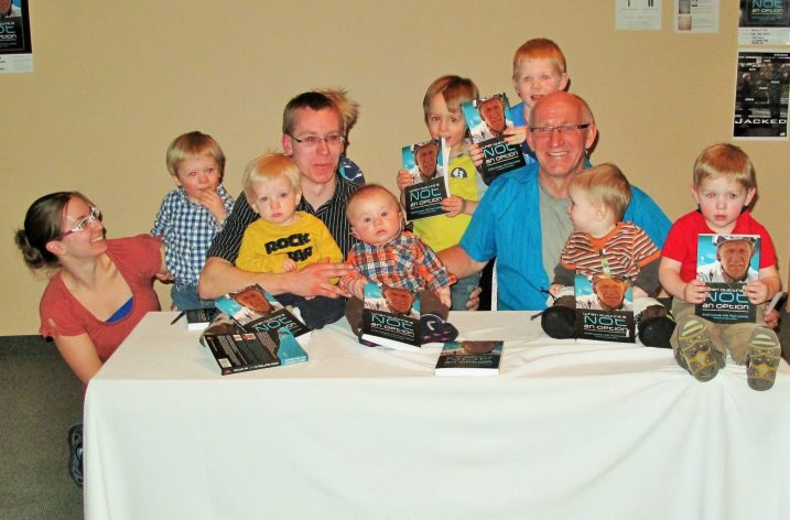 """Grandpas Can"" Arvid Loewen, biographer and son Paul Loewen, and the 8 grandchildren"