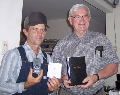 Norman Brown (r) gives a Bible and MP3 player to a Mennonite in Santa Cruz, Bolivia.  Photo: Dorothy Brown