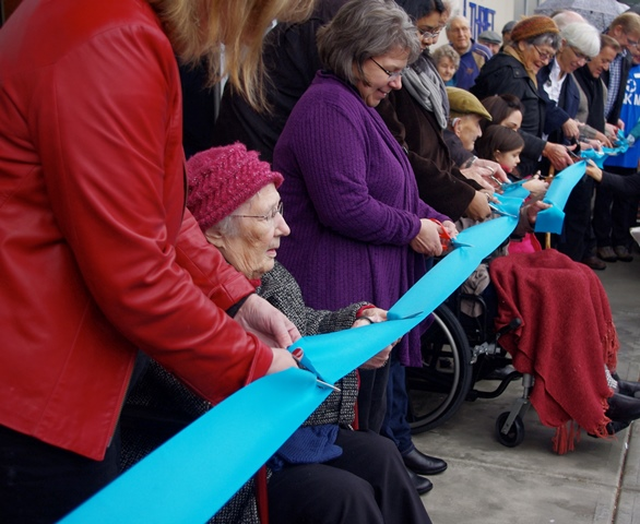 Thirteen people, representing different ages and departments of MCC, cut the ribbon during the official opening of the new Abbotsford building – held outdoors in the rain on Dec. 6. Among the ribbon cutters was long-time MCC B.C. board chair Siegfried Bartel, who turns 100 in January 2015.