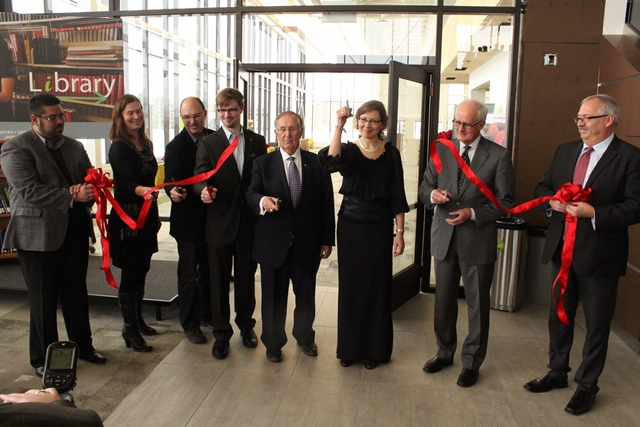 Ribbon-cutting at Marpeck Commons with (l-r) Elton DeSilva, MB Church Manitoba executive director; Marlene Janzen, CMU board of governors chair; Jerold Peters, ft3 principal architect; Josh Hollins, CMU Student Council president; Elmer Hildebrand, CMU capital campaign chair; Cheryl Pauls, CMU president; Ted Paetkau Concord Projects CEO, Willard Metzger, MC Canada executive director