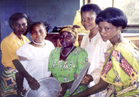 Several women from DR Congo (far left)display their handmade aluminum pots. Photos: David Wiebe