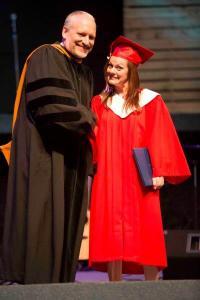 Joy Norris receives her diploma from president Bryan Born.
