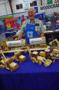 Jake Esau spends retirement time fashioning wheeled toys from hardwoods and softwoods. He is a regular at the annual MCC sale.