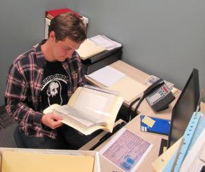 Archival intern Andrew Brown, deep in documentation.