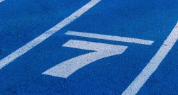 The number seven painted in white on a blue track | 7 Winning Ways to Attract Top Talent