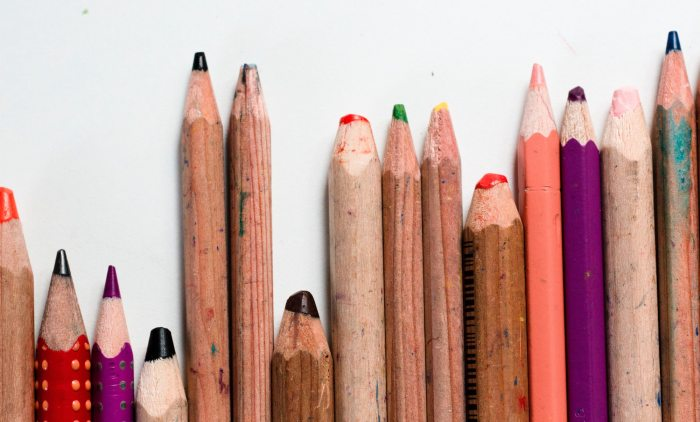 set of random used colored pencils, symbolizing critical skills and competencies: one of the top hr priorities for 2021 and beyond