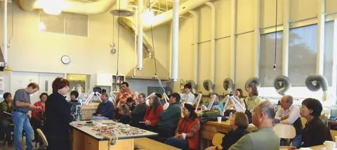 MBMAG members listen to a visiting artist lecture