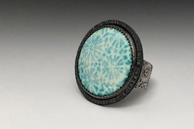 Carol Holaday Ring with Coral Like Pattern on Gray gradient background