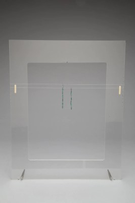 Acrylic frame stand for hanging objects shown with a pair of earrings