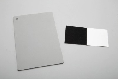 White balance neutral gray card and white cards stock with black velvet square