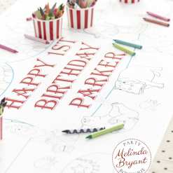 closeup of happy birthday message on circus coloring table runner