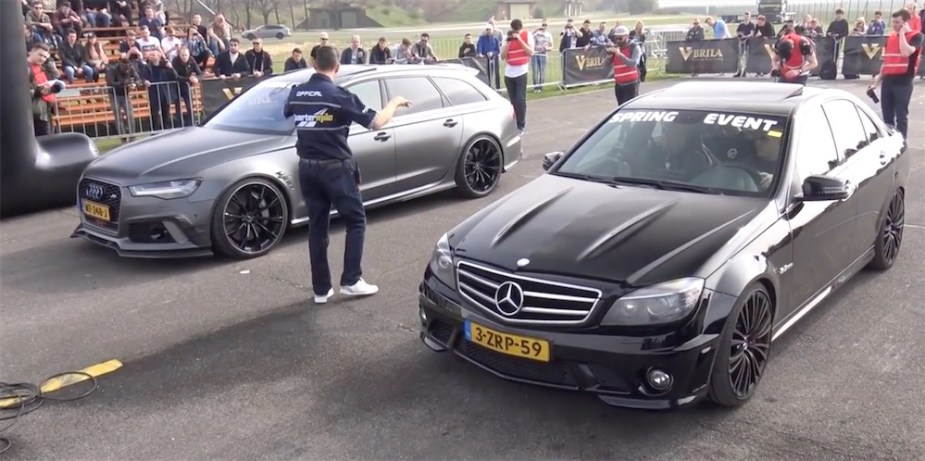 Modified Dutch C63 AMG drag racing an Audi.