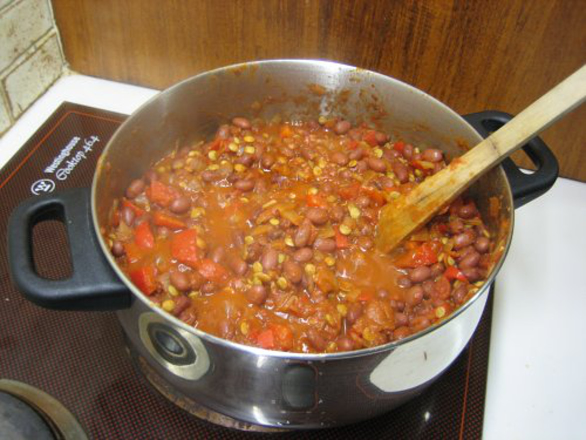 Pot of chili cooking on the stove
