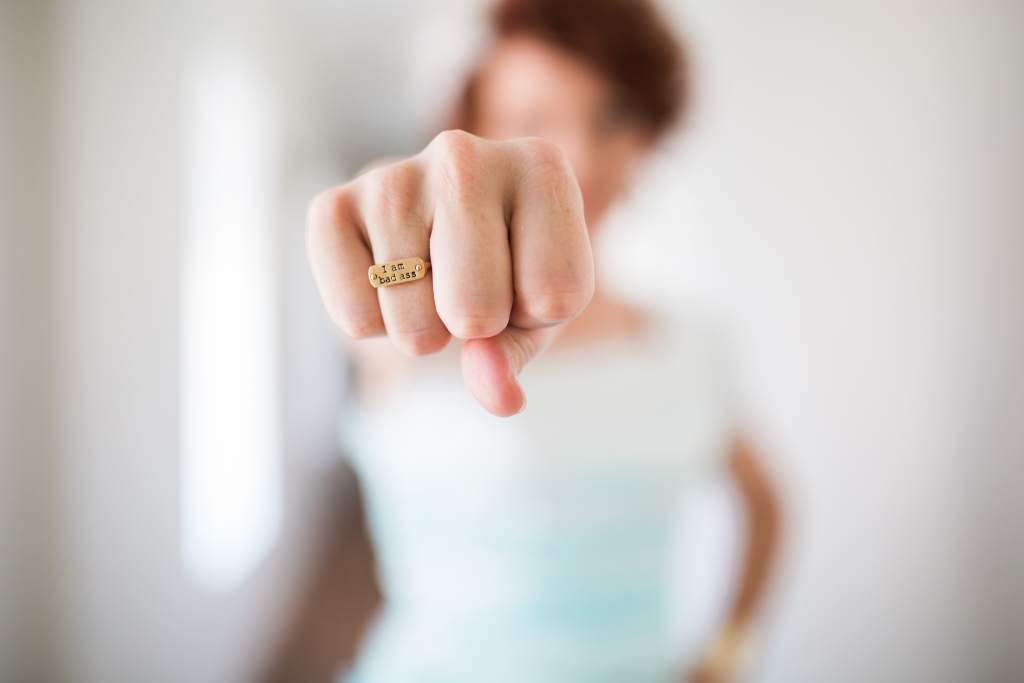 "Woman with a ring saying ""bad ass"""