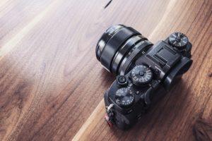 camera on wood table