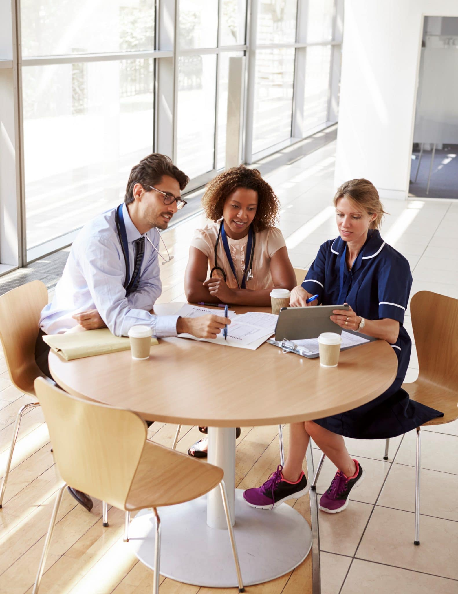 three senior healthcare workers in a meeting high P9BHPG7 1