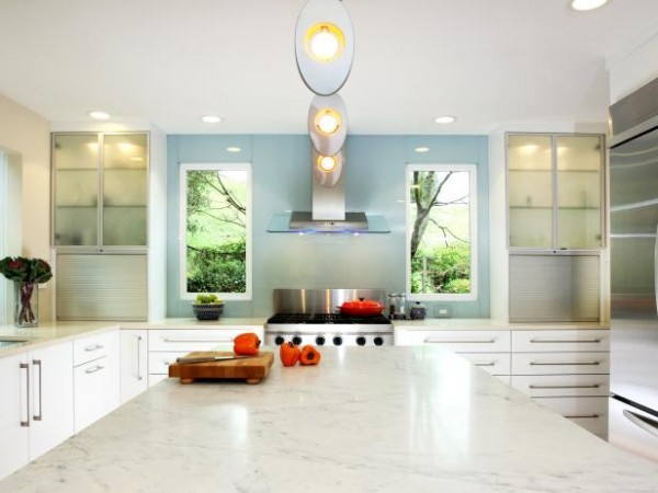 All white kitchens appear larger than same size kitchens of a darker color.