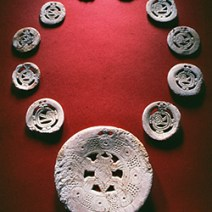 Shell Necklace, Mississippian period shell necklace with cutout and engraved spider, sun disk, and rattlesnake motifs
