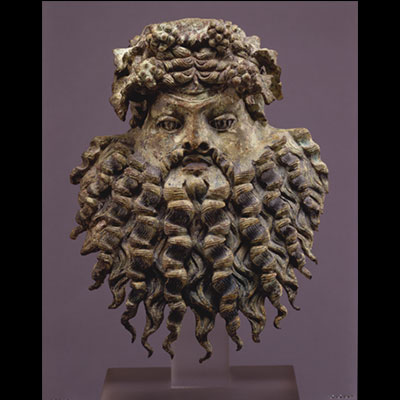 Bronze Dionysiac Mask; Vessel applique, Greco-Roman; first century BC, Ht. 7 3/4 in.