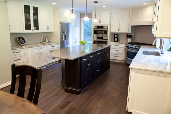 Dark wood cabinet island with white cabinets in kitchen