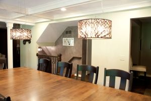 Looking across dining room table with open stairway beyond
