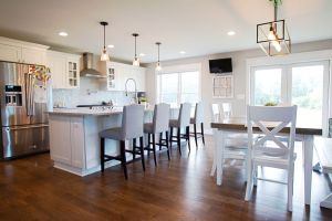 Open kitchen and eating area with white cabinets and trim