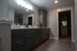 View of Master Bathroom vanity looking towards closet