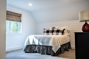 White and black bedroom in upper level