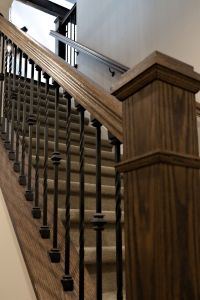 Oak Newel post and hand rail with iron ballusters