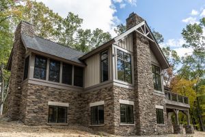 Two stone chimneys on cabin in the woods