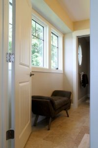 Small bench set below a window in the master bathroom