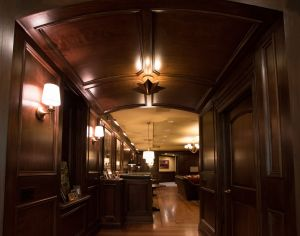 Curved wood paneled ceiling at entry to ballroom