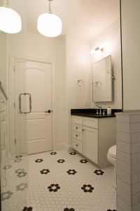 White tile with black accents in a retro bathroom